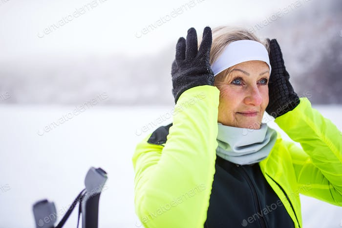 Senior woman getting ready for skiing.