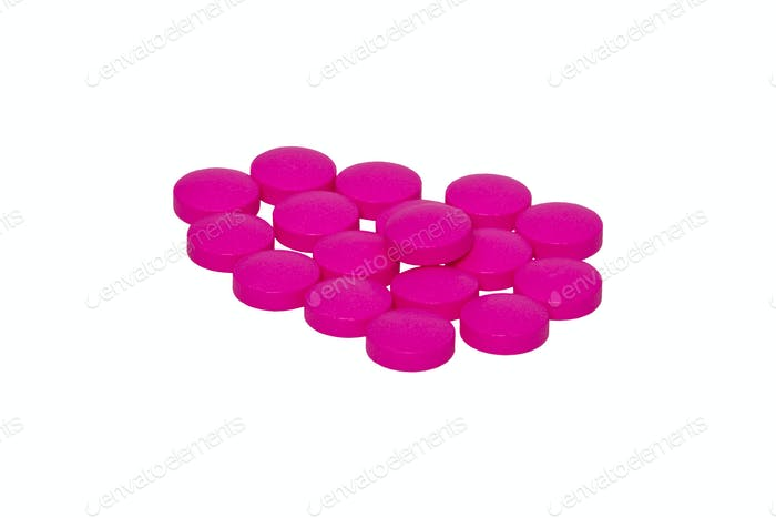Pink pills on a white background