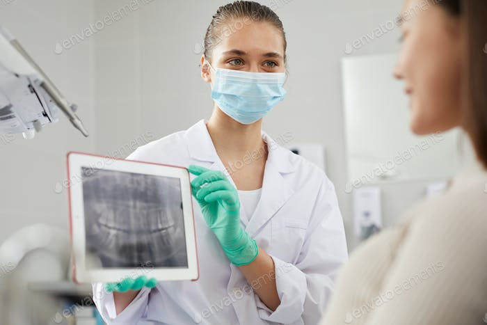 Dentist Holding X Ray Image