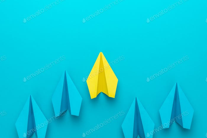 Leadership Concept With Paper Planes On Turquoise Blue Background And Copy Space