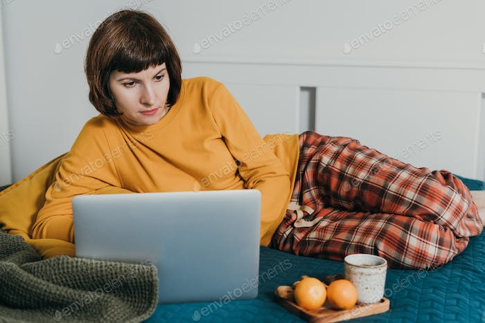 Work from home, distance learning, surfing Internet in morning after waking up