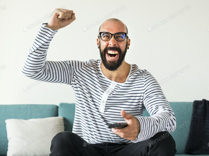 Cheerful person sitting on the couch