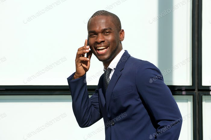 corporate african american businessman talking cellphone outdoors