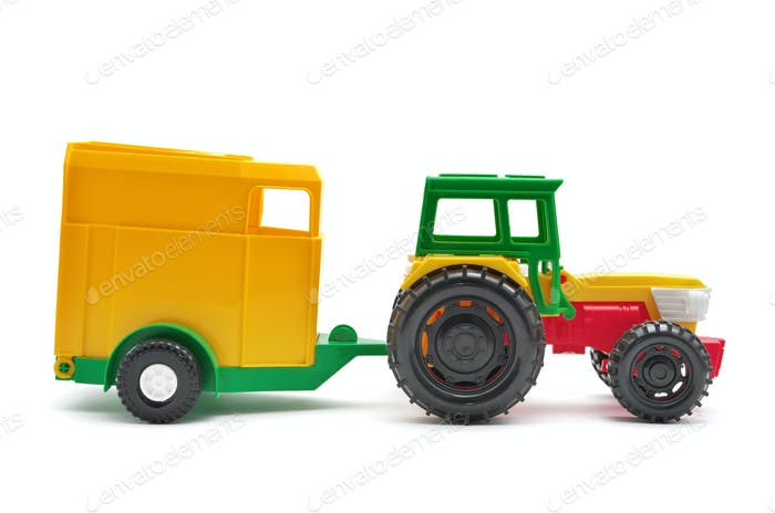 Toy tractor isolated.