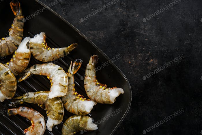 Raw tiger king shrimps on pan
