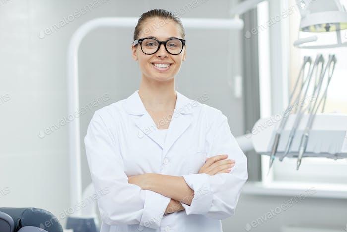 Female Dentist Posing in Office