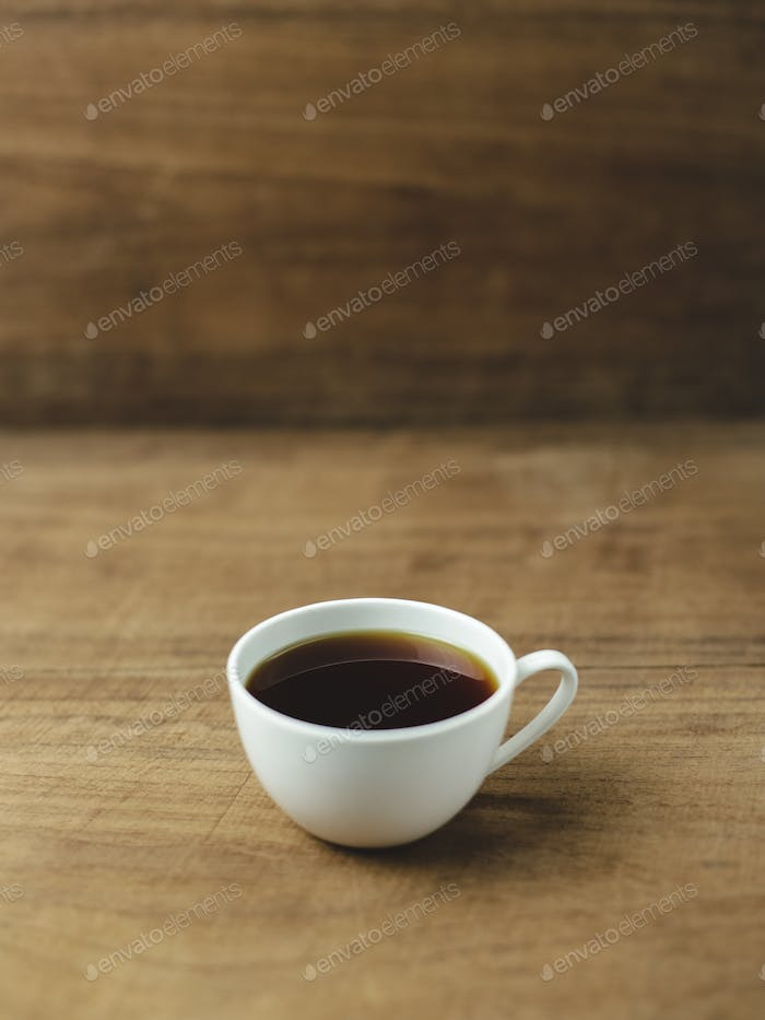 black coffee with wood background