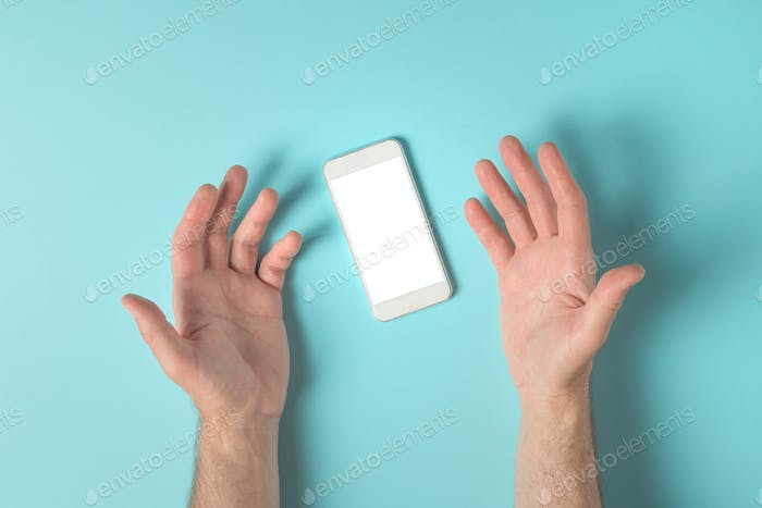 Frustrated male hands over smartphone screen mock up