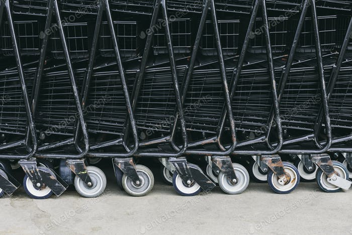 Supermarket trollies, carts stacked together.