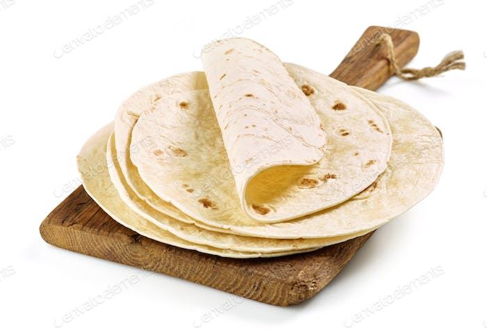 empty tortillas on wooden cutting board