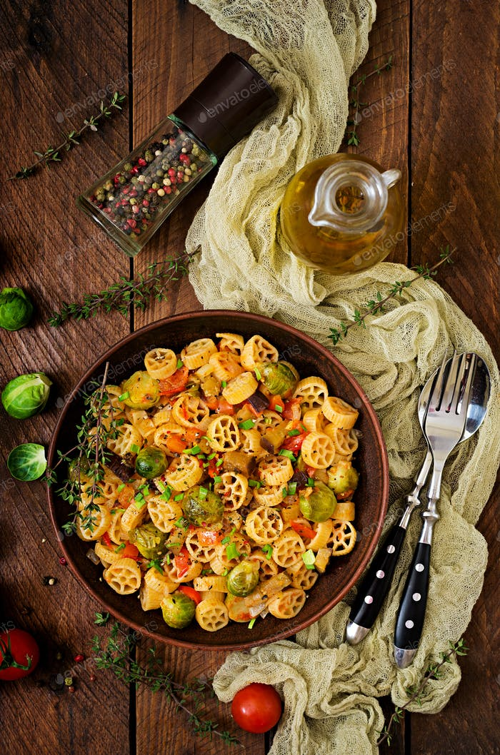 Vegetarian Vegetable pasta Rocchetti with brussels sprouts, tomato, eggplant and paprika