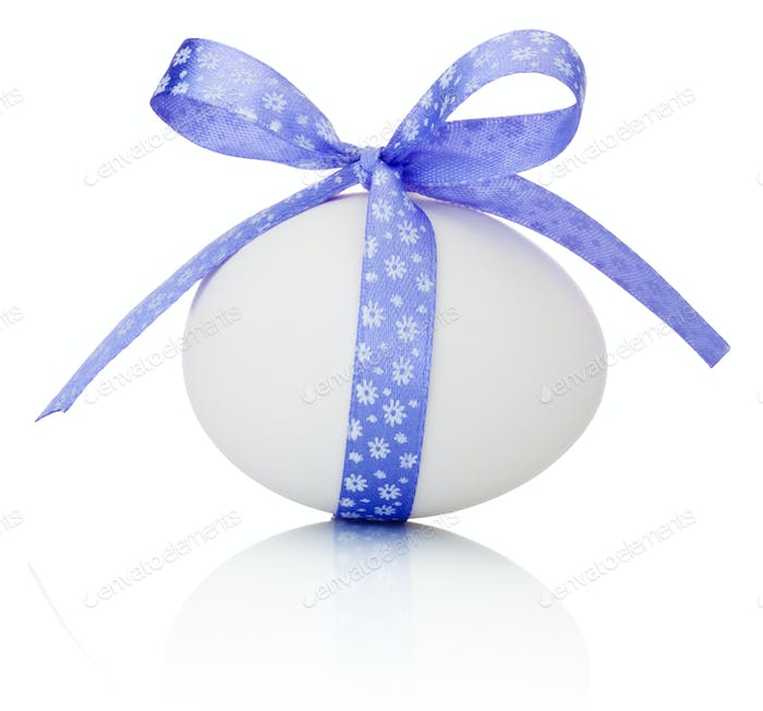 Easter egg with festive purple bow isolated on white background