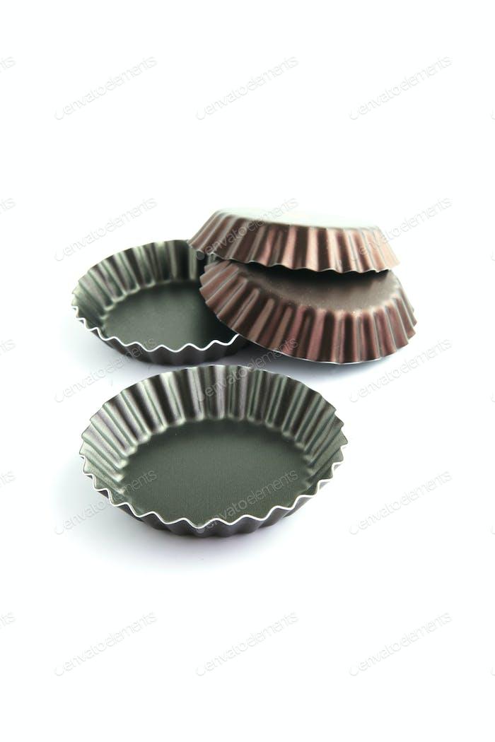 Four corrugated cake tins