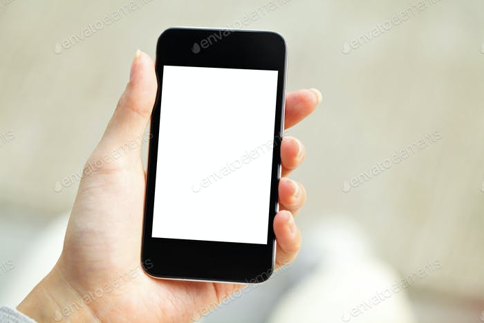 Hand holding mobile phone with blank screen