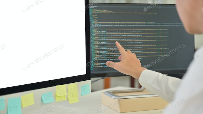 The programmer is checking the data.He pointed at the computer screen.
