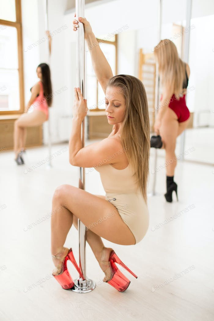 Woman by pole