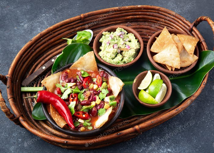 Mexican black bean soup with homemade fried tortillas totopos nachos served with guacamole
