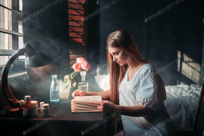 Young sick woman reading book at the hospital