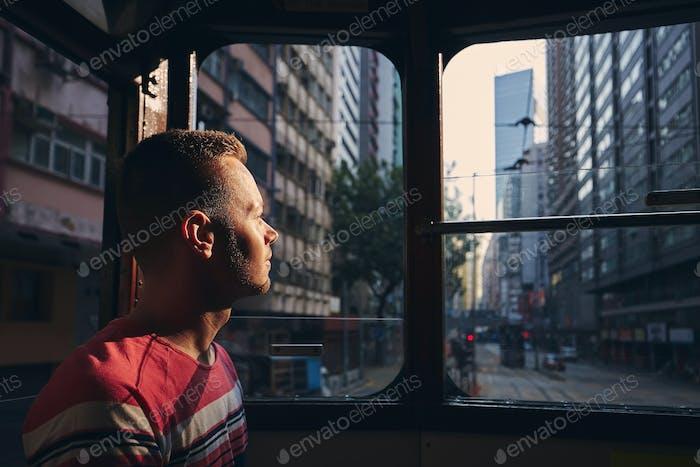 Tourist exploring city streets of Hong Kong