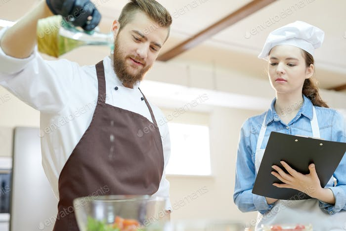Young Chef Working in Restaurant