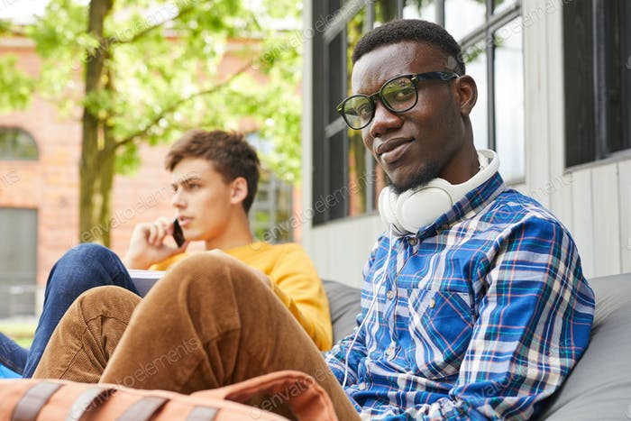 African-American Student Relaxing Outdoors