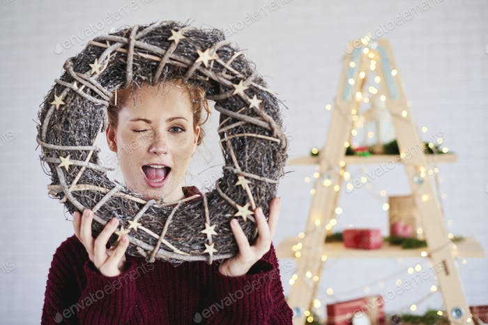 Screaming woman holding christmas wreath