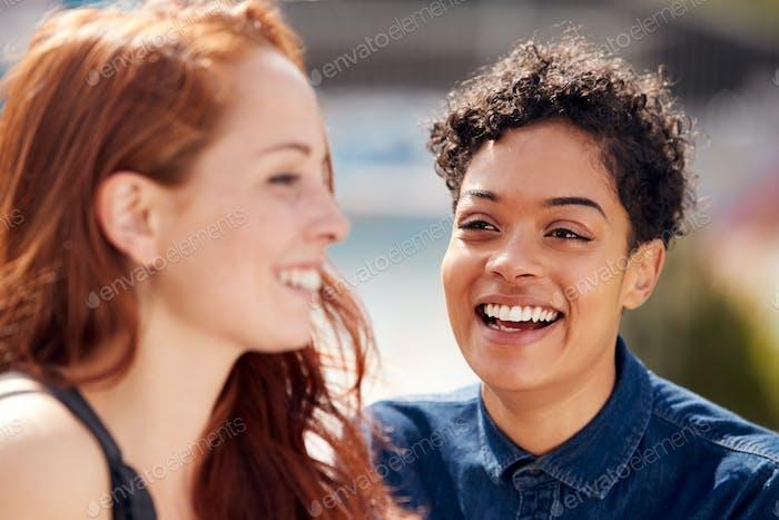 Two Female Friends Meeting In Urban Skate Park