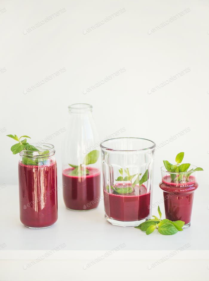 Fresh beetroot smoothie or juice in glasses with mint
