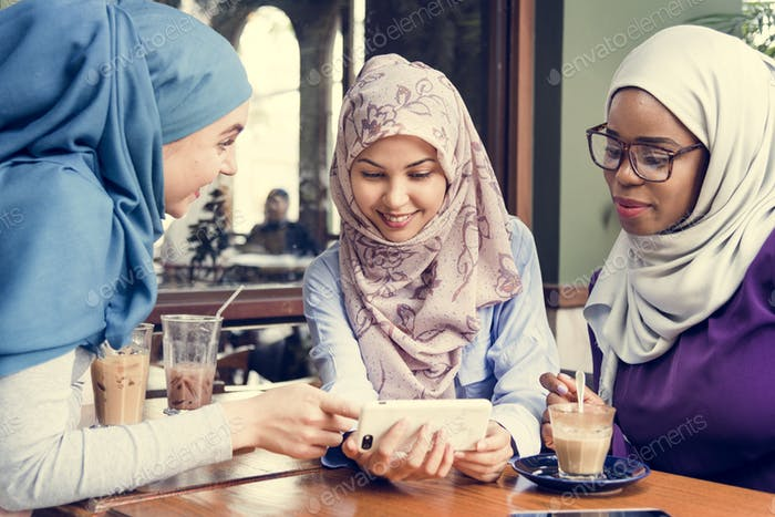 Group of islamic women looking at smartphone