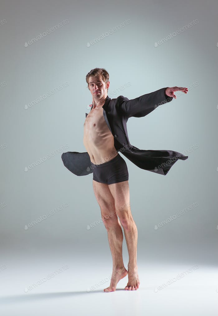The young attractive modern ballet dancer on gray background