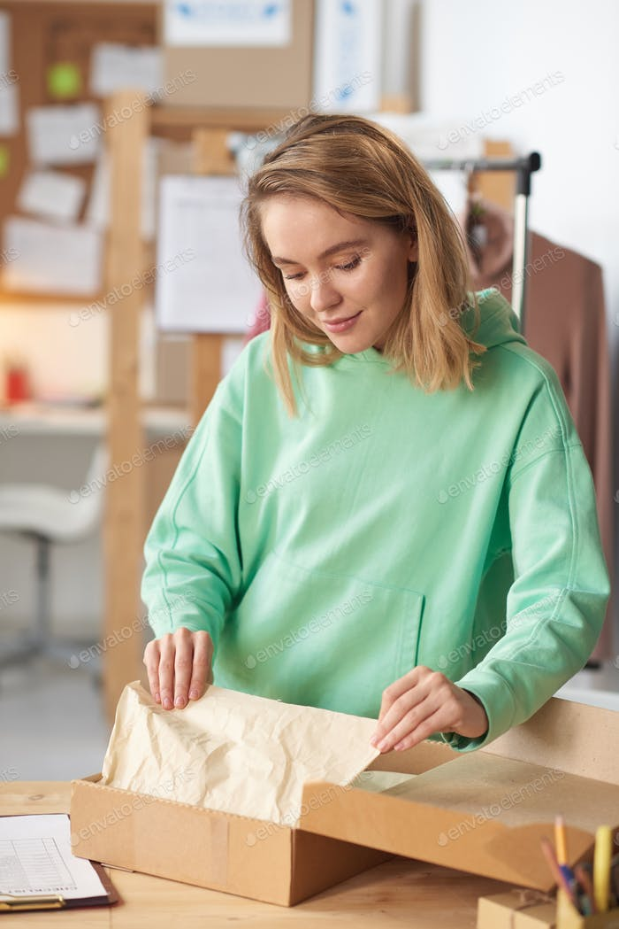 Woman packing the parcel
