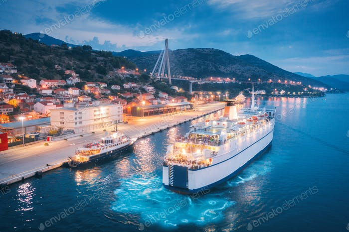 Aerial view of cruise ship in port at night. Landscape