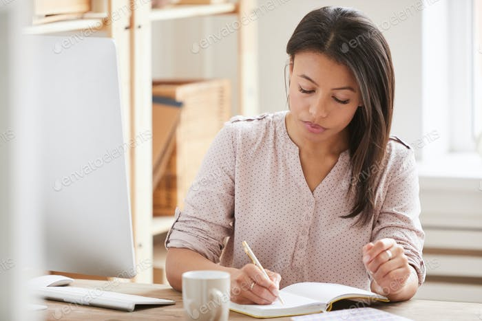 Mixed Race Woman at Desk in Offce