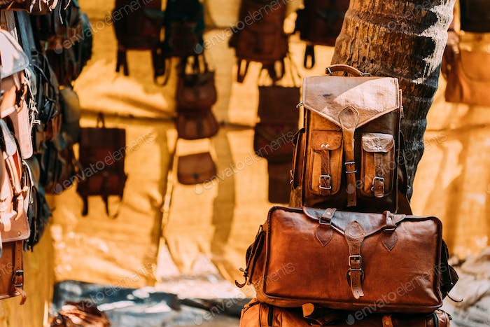 Market Shop With Leather Goods - Bags, Wallets, Backpacks, Briefcases Different Colors And Sizes
