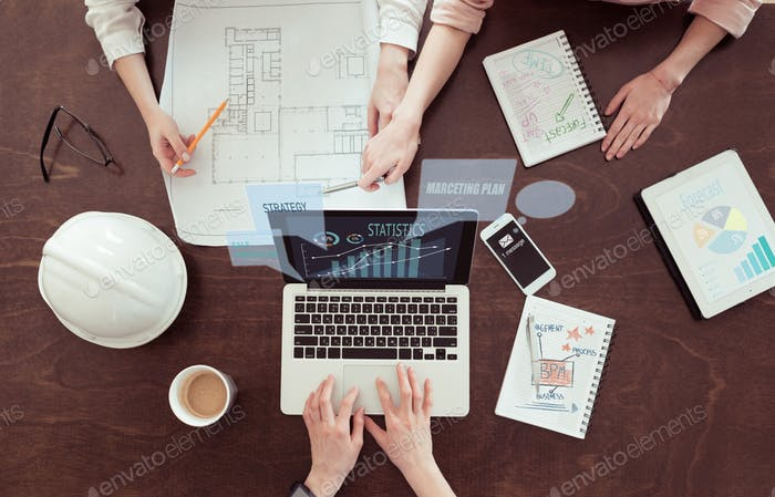 business team of architects working on project