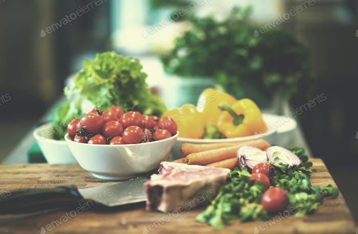Juicy slice of raw steak on wooden table