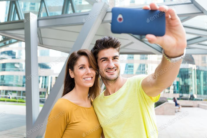 Young couple take selfie by smart phone