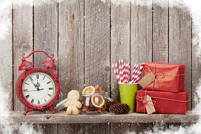 Christmas gift boxes, alarm clock and food decor
