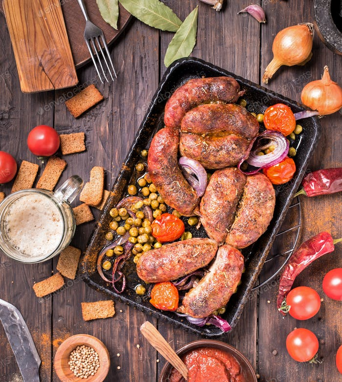 Rustic beef sausages on table