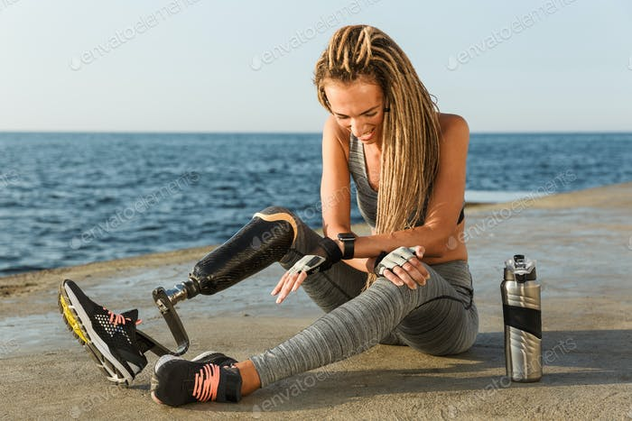 Laughing disabled athlete woman with prosthetic leg