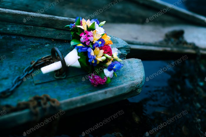Wedding bouquet. Flowers in boat.