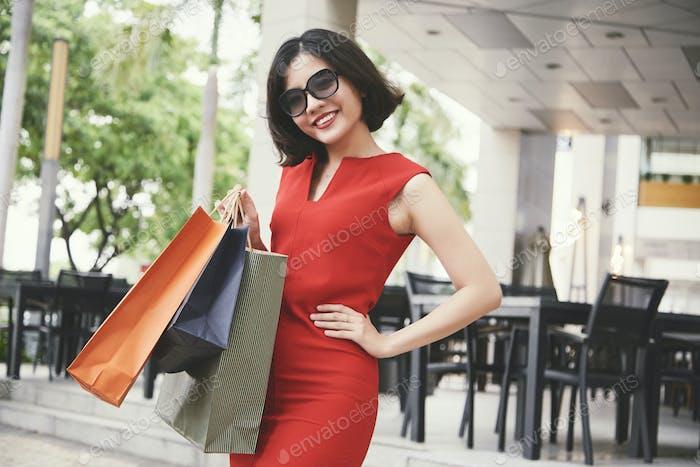 Portrait of happy shopaholic
