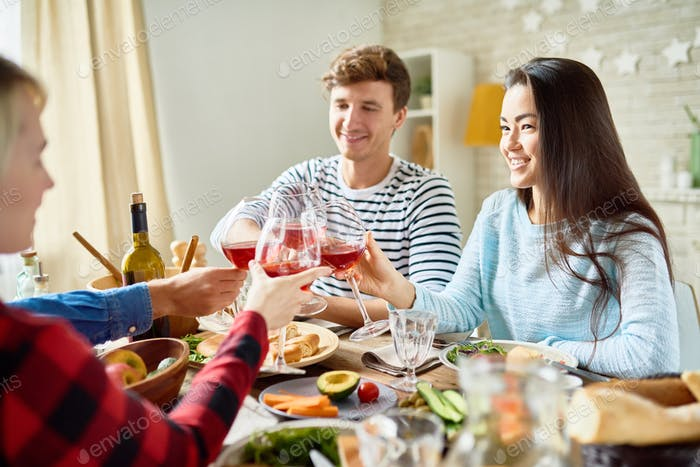 Friends Toasting at Thanksgiving Dinner