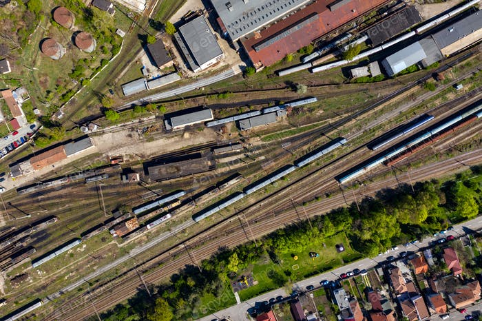 Aerial drone view of old locomotive train depo, parking iron horses on railway routes. Diesel engine