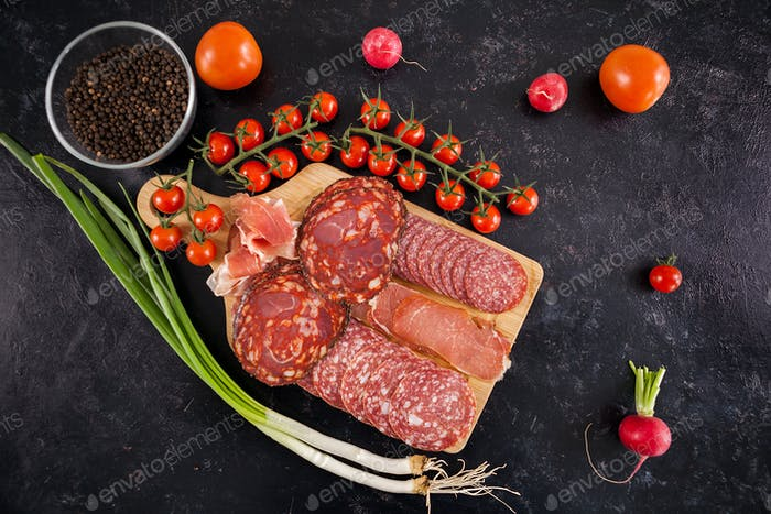 Top view of delicious healthy meat appetizers on wooden board