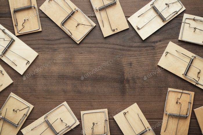Many Mousetraps On The Wooden Background