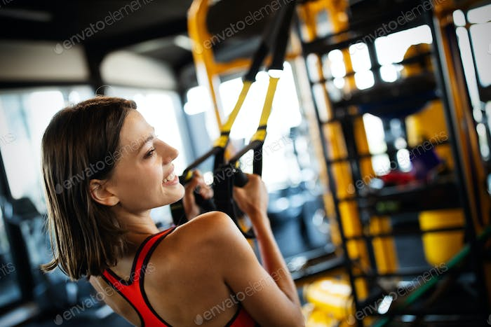 Portrait of a beautiful fit sporty woman in gym