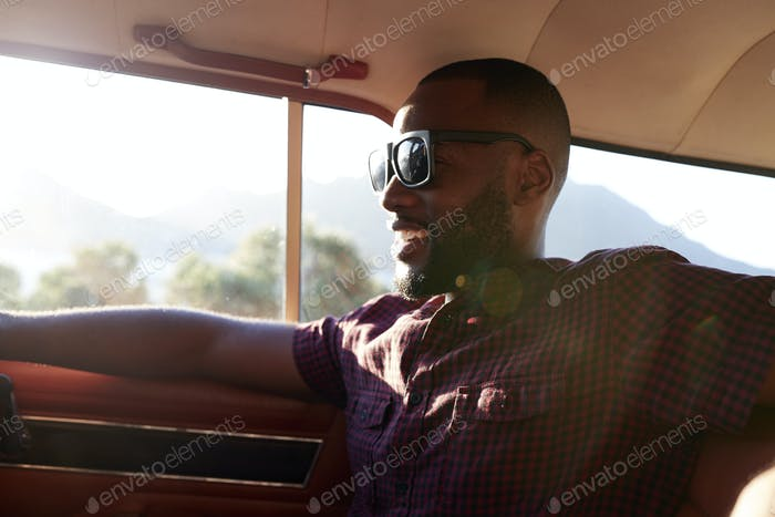 Man Relaxing In Car During Road Trip