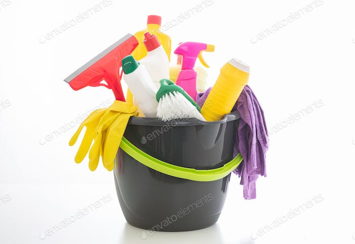 Cleaning supplies in a bucket isolated against white background.