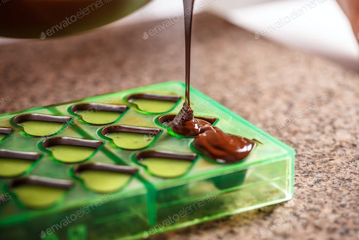 Pouring chocolate in mold